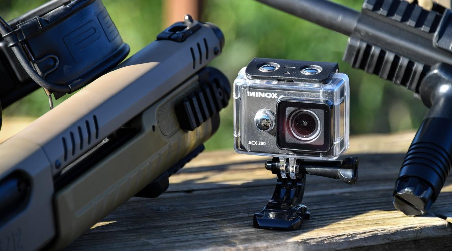 Minox ACX-300 Action Camera and a some firearms used to test it.