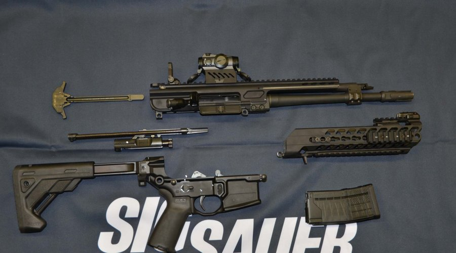 SIG Sauer MCX assault rifle disassembled into main components